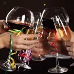 15440057-celebration-people-holding-glasses-of-white-wine-making-a-toast